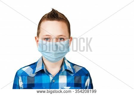 Unhappy, Sad Young Boy Wearing A Protective Face Mask Prevent Virus Infection Or Pollution On White