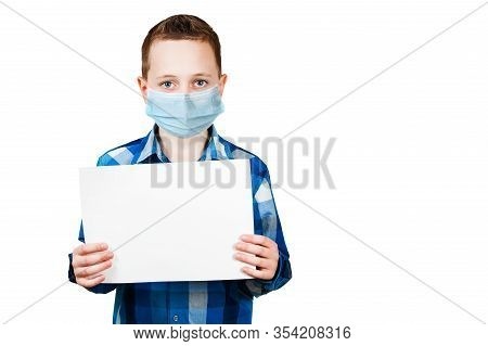 School Boy Hold Blank Sign With Copy Space, Wearing A Protective Face Mask Prevent Virus Infection,
