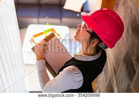 Close Up Top View Of Construction Inspector Woman Wearing A Pink Hard Hat, She Looking For Molds Or