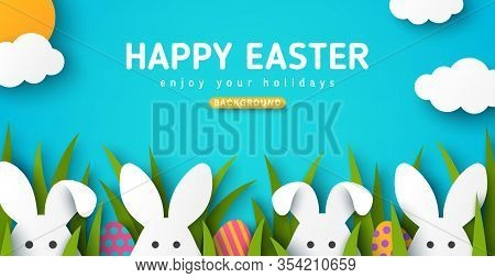 Easter Card With White Bunny Rabbits, Colorful Eggs And Green Grass. Blue Sky Background With Sun An