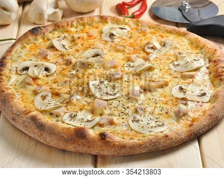 Pizza Chicken With Mushrooms On A Wooden Board