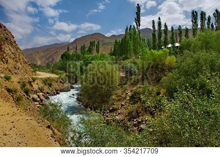 Tajikistan. The Right Tributary Of The Border River Panj Along The Pamir Tract Near The City Of Khor