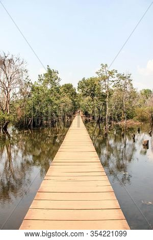 Wooden Bridge Over A Small River In Ankor Wat. Connection Between Two Temples, Cambodia