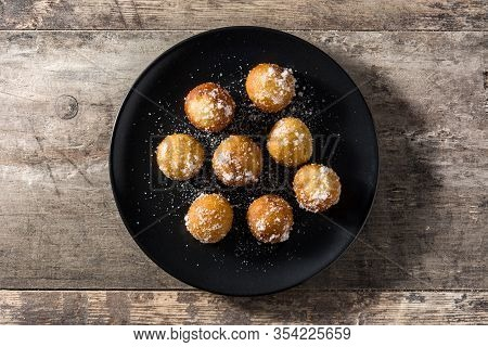 Carnival Fritters Or Buñuelos De Viento For Holy Week On Wooden Table. Top View