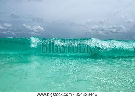 Turquoise Water And Big Waves In Seychelles, La Digue Beach. Travel And Vacation