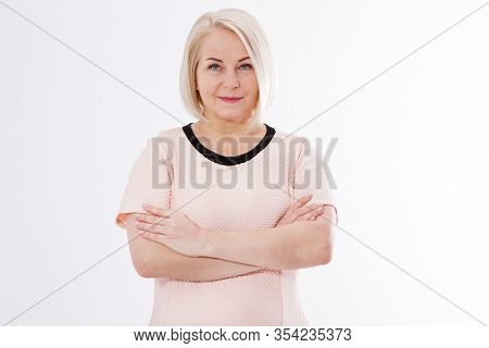 Elegant Middle Aged Woman Posing With Pink Dress Over White