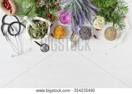 Variety Of Herbs And Herbal Mixtures As An Alternative Medicine Concept On Wooden Table Background T