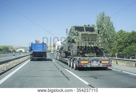 Seville; Spain - May 31st, 2019: Heavy-duty Truck Carrying Spanish Army Lorry. Road Convoy With Mili
