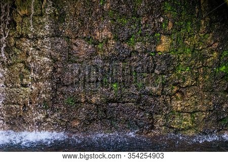 Water Running Down A Stone Wall As A Part Of A Fountain In Grasse (france)