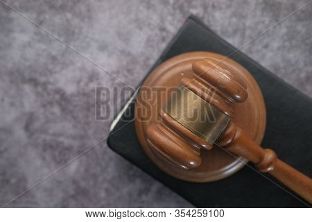 Close Up Of Gavel On Table Against American Flag