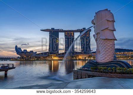 SINGAPORE CITY SINGAPORE: FEBRUARY 13 2020: Singapore Merlion Park downtown Singapore  business district at sunrise
