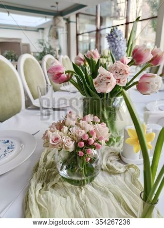 Table Set For An Event Party Or Wedding Reception - Fresh Rose And Pink Tulipa Flowers In Vase