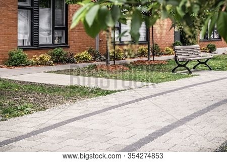 Paved Path Leading To A Brick Residential Building. Modern City Neighborhood In Spring.