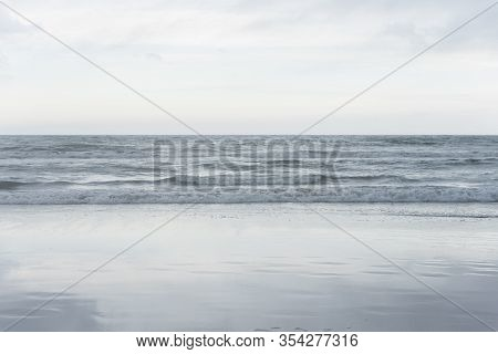 Beach Landscape, Calm Sea And Cloudy Sky Reflected In The Wet Sand Of The Shore, In Mar Del Plata, P