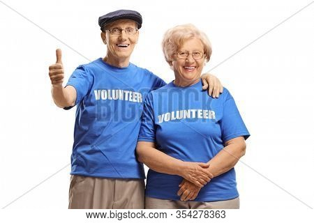 Elderly man and woman volunteers smiling at the camera and giving thumbs up isolated on white background