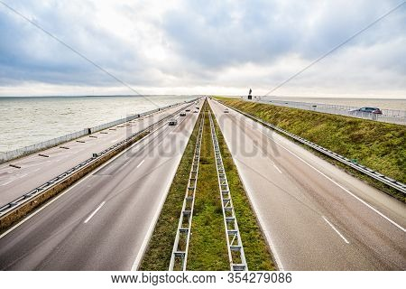 Den Oever, Netherlands - January 09, 2020. Highway Between Two Sees On The North Of Netherlands Spli