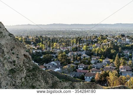 North San Fernando Valley homes in Los Angeles, California.  The Santa Monica Mountains are in the background.