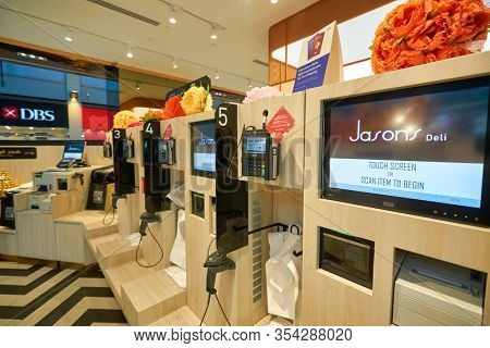 SINGAPORE - JANUARY 20, 2020: self-checkout facilities at Jasons Deli in the Shoppes at Marina Bay Sands. Jasons Deli is a supermarket and delicatessen.