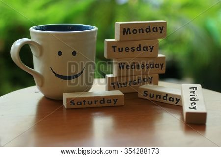 Everyday Is A Good Day Concept. With Happy Smiling Face Emoticon On A Coffee Cup. And The Names Of T