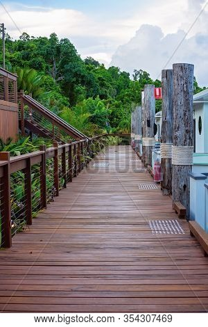 A Timber Boardwalk Joining Boat Accommodation With Stairs At A Simulated Jetty, With Bushland At The