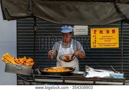 Bangkok, Thailand - Feb 16, 2020 : Chef Is Frying Chinese Deep Fried Dough In Hot Oil On Steel Pan.