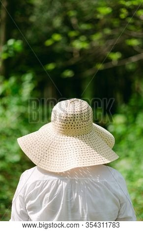 Woman With Hat In The Garden, selective focus