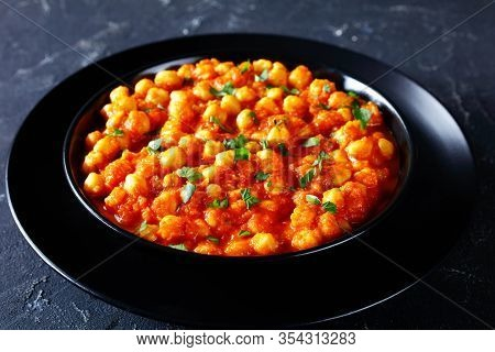 Indian Festive Main Course Chana Masala Or Chickpea Curry With Spices, Tomato Sauce, Onion, Garlic,