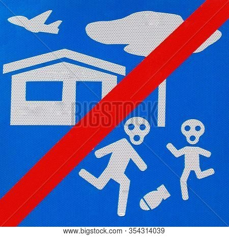 No Bomb Sign On Blue Background. Stop The Bombing Concept