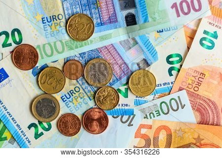 World Of Money. Various Euro Notes And Coins As Background.