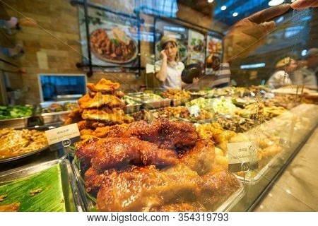 SINGAPORE - JANUARY 20, 2020: prepared food on display seen at a food court in the Shoppes at Marina Bay Sands