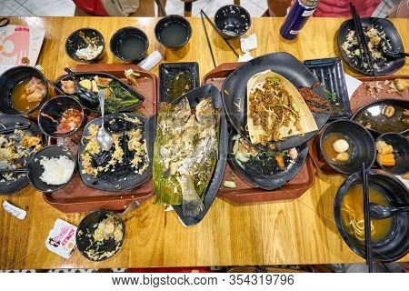 SINGAPORE - JANUARY 20, 2020: messy table after meal at a food court in the Shoppes at Marina Bay Sands