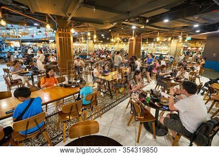 SINGAPORE - JANUARY 20, 2020: people eating at a food court in the Shoppes at Marina Bay Sands
