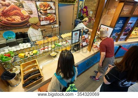 SINGAPORE - JANUARY 20, 2020: a man ordering meal at a food court in the Shoppes at Marina Bay Sands