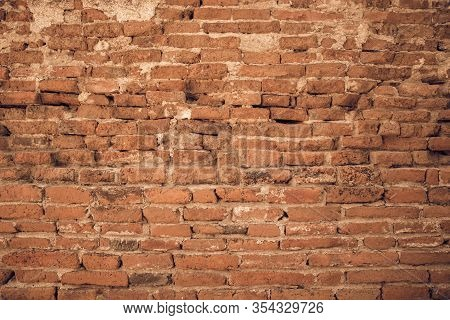 Old Red Brick Wall Frame Textrue. Empty Brick Wall Background. Fragment Of Brick Masonry With Plaste