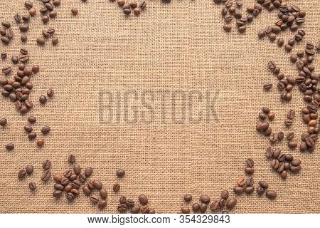 Coffee Beans On A Sackcloth Or Sackcloth Texture Background Wallpaper Of Linen Fabric Canvas. Blanke