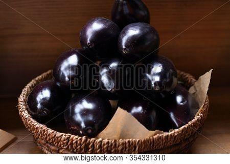 Fresh Eggplants In A Wooden Basket. Preparation For Conservation. Harvesting Eggplants. Spring Avita