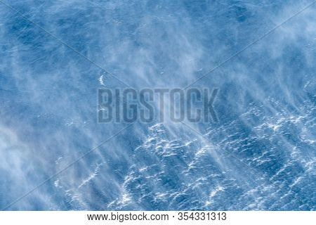 Water Mist And Turbulence Flow Of Wave Created By The Helicopter Hop Over The Sea Water Surface.