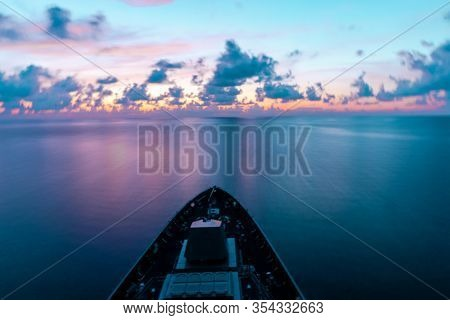 Motion Blur Of Modern Warship Sails Through The Sea With Civil Twillight Ray. Photo With Low Speed S
