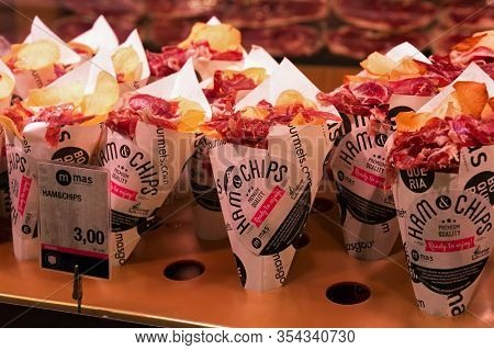 Barcelona, Spain - May 16, 2017: Paper Cornets With Potatoes Chips And Sliced Jamon As Fast Meat Del