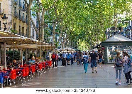 Barcelona, Spain - May 16, 2017: Unknown Tourists Walking On The Famous Pedestrian Street La Rambla