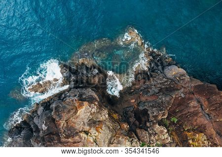 Top Aerial View Of Turquoise Atlantic Ocean Water Waves Crashing On Rocks On The Portuguese Madera I