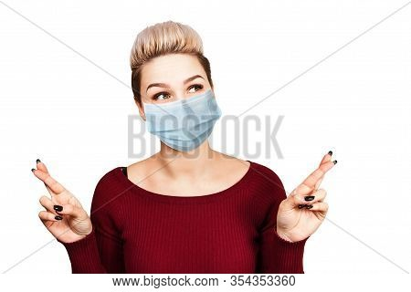Portrait Young Woman With Cross Fingers. Wearing Protective Face Mask Prevent Virus Infection, White