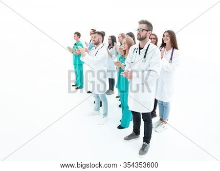 image of a large group of applauding medical professionals.