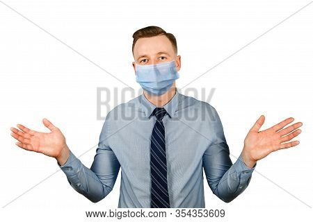 Man In Blue Shirt And Tie Shrugs, Wearing A Protective Face Mask Prevent Virus Infection On White Is