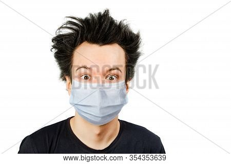 Unhappy, Mad Guy Man Wearing A Protective Face Mask Prevent Virus Infection Or Pollution On White Is