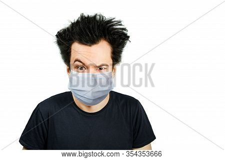 Unhappy, Mad Person Wearing A Protective Face Mask Prevent Virus Infection Or Pollution On White Iso