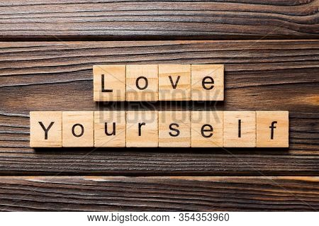 Love Yourself Word Written On Wood Block. Love Yourself Text On Wooden Table For Your Desing, Top Vi