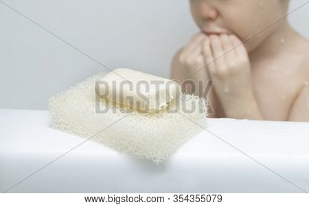 Bar Soap With Tooth Marks Closeup. Small Child Boy Bit Off Bar Of Soap And Bit His Mouth. Humor Conc