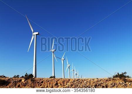 Desert Hill Wind Turbine Farm Bright Blue Sky