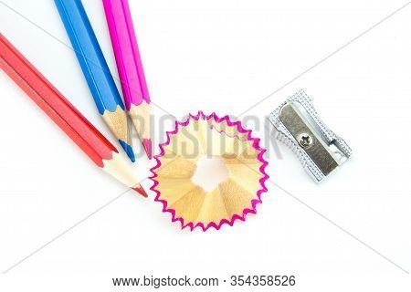 Three Wooden Pencils (blue, Red, Pink), A Metal Small Sharpener And Beautiful Curled Shavings From S